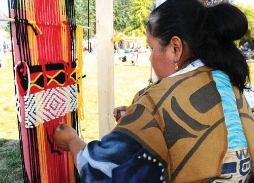 Coast Salish weaver Joy Joseph-McCullough created a wool piece during a recent festival. She also does cedar weaving work.